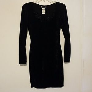 Black form fitting black dress